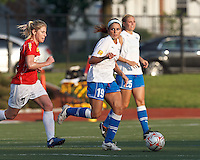 Boston Breakers defender Bianca D'Agostino (19) looks to pass as Western New York midfielder McCall Zerboni (7) closes. In a Women's Premier Soccer League Elite (WPSL) match, the Boston Breakers defeated Western New York Flash, 3-2, at Dilboy Stadium on May 26, 2012.