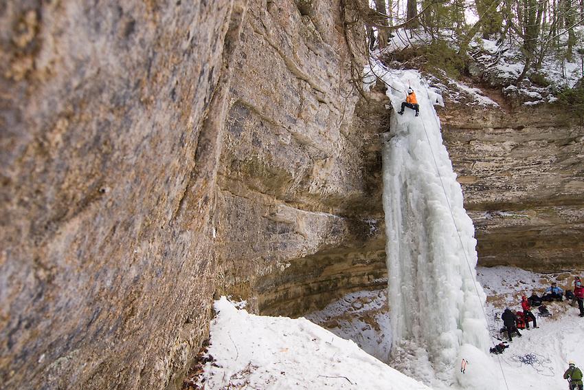 Ice climbing during Michigan Ice Fest at Pictured Rocks National Lakeshore in Munising Michigan Upper Peninsula.