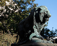 Low angle view of the statue called Lion tuant une chevre or Lion et mouflon (Lion killing a goat), created by Paul Jouve circa 1937 and located in front of the Art Deco Fauverie (the big cats building) built by Rene Berger, in the Menagerie of Jardin des Plantes, Paris, 5th arrondissement, France. The bronze statue of the Lion tuant une chevre was cast by the Fonderie Rudier, a foundry created in 1792 and also producing Auguste Rodin, Aristide Maillol and Antoine Bourdelle master pieces. Founded in 1794 by Jacques Henri Bernardin de Saint-Pierre, the Menagerie of Jardin des Plantes became the largest exotic animal collection in Europe in the 19th century and is the second oldest public zoo in the world. Picture by Manuel Cohen