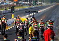 Sep 23, 2016; Madison, IL, USA; Crew members with NHRA top fuel driver Terry McMillen during qualifying for the Midwest Nationals at Gateway Motorsports Park. Mandatory Credit: Mark J. Rebilas-USA TODAY Sports