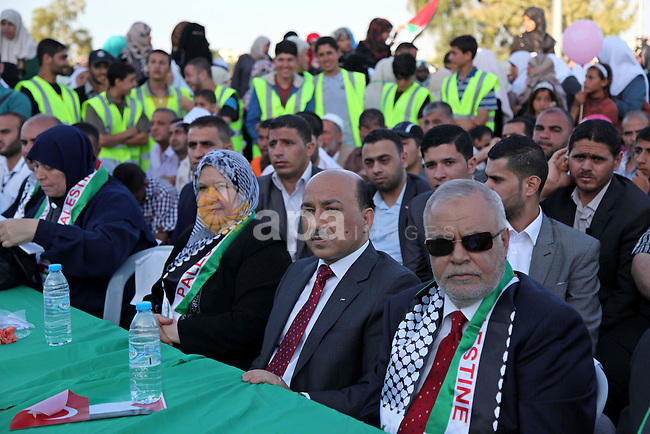 Palestinian Ministers of unity government attend a mass wedding ceremony in Gaza City, on May 31, 2015. Nearly 2000 Palestinian couples were married in a ceremony funded by the Turkish government and supported by the Hamas . Photo by Ashraf Amra