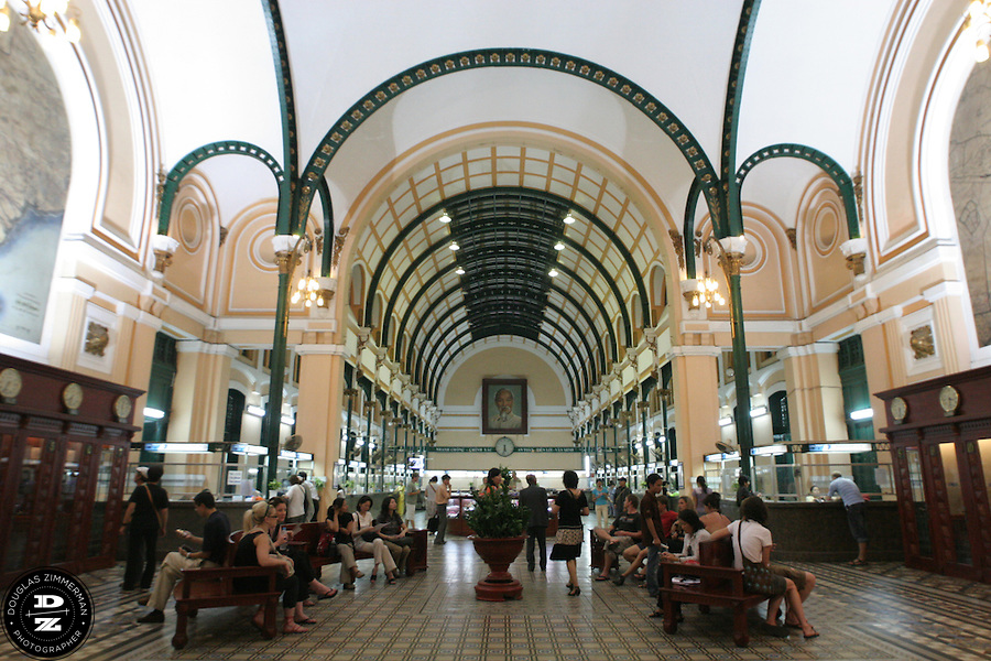 Ho Chi Minh City's French-style main post office in downtown Ho Chi Minh City, Vietnam attracts tourists as well as local residents conducting postal business.  Photograph by Douglas ZImmerman
