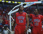 Ole Miss guard Zach Graham (32)  and Ole Miss guard Nick Williams (20) celebrate Graham's made basket as he was fouled at the C.M. &quot;Tad&quot; Smith Coliseum in Oxford, Miss. on Tuesday, February 1, 2011. Ole Miss won 71-69.
