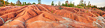 Panorama of gorgeous Martian like landscape formed from red and gray eroded clay. Cheltenham Badlands Ontario Canada