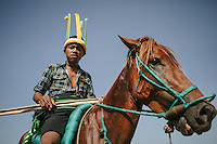 A Pasola warrior poses with his prized horse for photographs before the start of Pasola at Homba Kalayo. Horse is an important creature for Sumbanese tradition.