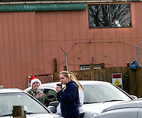 Supporters of the Olympic Animal Sanctuary in Forks, WA share hot drinks in the driveway on December 15, 2013.  One of the supporters who later asked not to be identified said she&rsquo;s out here because &ldquo;I believe in his golden heart and good intentions with these dogs. I believe he has an unbelievable gift and he&rsquo;s pursuing that.  And I support him.&rdquo;<br /> <br /> Owner Steve Markwell Markwell has been under fire for neglecting the dogs after volunteers filed a complaint in 2012. The City of Forks police department investigated and found horrific conditions but said legally they were unable to do anything about it. Markwell claims he has 125 dogs inside and believes he is their last hope.  Many of the dogs were turned over to him by rescues and shelters who deemed them dangerous. Mounting evidence of animal cruelty has prompted many of them to ask for their dogs back.  Markwell refuses and only lets a few trusted volunteers enter the premises. <br /> <br /> As a volunteer in a vet&rsquo;s office she said she&rsquo;s met Steve regularly when he visits a couple days a week. The dogs do not accompany him. She is here today because she felt the protesters were getting out of hand over the weekend and reported they ripped supporting signs down from a coffee shop.  &ldquo;They tore them up and stomped on them in a mud puddle.&rdquo;<br /> <br /> The anonymous woman who supports Steve Markwell said she feels like she was attacked on a social media page for making a comment and had received a threatening voice mail this morning that came from an unknown caller. &ldquo;I heard that you stand with OAS.  Well, I know your address.&rdquo;<br /> <br /> No one from the fours cars humming in the driveway were seen entering the building though owner Steve Markwell spent about an hour inside in the morning. &ldquo;I see this man crumbling.&rdquo; she said. &ldquo;This is so much pressure to put him under for a job that nobody else is willing to do.&rdquo;