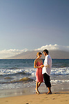 Couple on the beach at at the Four Seasons Wailea, Maui, Hawaii