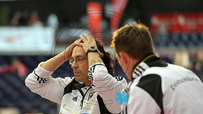 European Championships Fencing 2010 / Fecht Europameisterschaft 2010 in Leipzig - Competition Championat d'europe - im Bild: mens epee team competition - the german national coach Didier Olagnon (l) after losing the semi finale  . Foto: Norman Rembarz..Norman Rembarz , Autorennummer 41043728 , Augustenstr. 2, 04317 Leipzig, Tel.: 01794887569, Hypovereinsbank: BLZ: 86020086, KN: 357889472, St.Nr.: 231/261/06432 - Jegliche kommerzielle Nutzung ist honorar- und mehrwertsteuerpflichtig! Persönlichkeitsrechte sind zu wahren. Es wird keine Haftung übernommen bei Verletzung von Rechten Dritter. Autoren-Nennung gem. §13 UrhGes. wird verlangt. Weitergabe an Dritte nur nach  vorheriger Absprache..