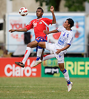 Brayan Landaverde (6) of El Salvador tries to clear the ball away from Jean Scott (19) of Costa Rica during the group stage of the CONCACAF Men's Under 17 Championship at Jarrett Park in Montego Bay, Jamaica. Costa Rica defeated El Salvador, 3-2.