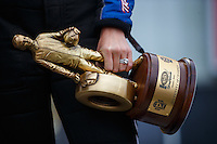 May 1, 2016; Baytown, TX, USA; Detailed view of the Wally trophy in the hand of NHRA funny car driver Courtney Force after winning the Spring Nationals at Royal Purple Raceway. Mandatory Credit: Mark J. Rebilas-USA TODAY Sports