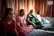 Pregnant as a surrogate mother for first time, 20 year old Vaishali Sanket (left) is seen with other surrogate mothers in Rabina's house in Anand, Gujarat, India. Rabina now mentors surrogate mothers and houses women throughout theior pregnancy.