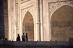 An Indian family wanders along the balcony of the Taj Mahal.