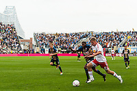 Jan Gunnar Solli (8) of the New York Red Bulls is defended by Raymon Gaddis (28) of the Philadelphia Union. The New York Red Bulls defeated the Philadelphia Union 3-0 during a Major League Soccer (MLS) match at PPL Park in Chester, PA, on October 27, 2012.