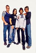 AUDIOSLAVE - L-R: Tim Commerford, Brad Wilk, Tom Morello, Chris Cornell - Photosession in Los Angeles CA USA - October 2002.  Photo credit: Annamaria DiSanto/IconicPix