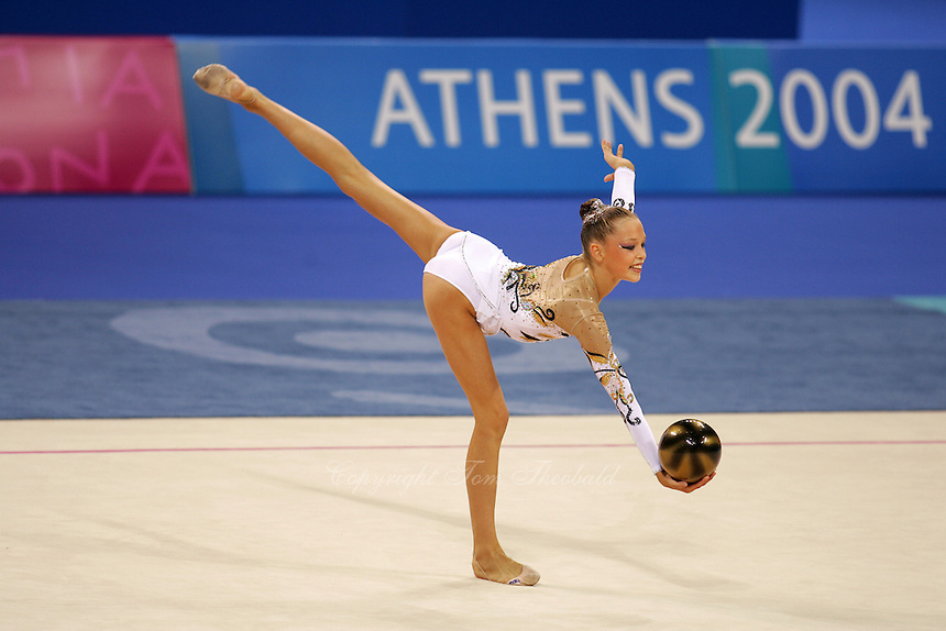 Dominika Cervenkova of Czech Republic holds  balance with ball during qualifications round at 2004 Athens Olympic Games on August 26, 2006 at Athens, Greece. (Photo by Tom Theobald)