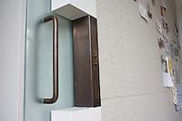Steel door handle on interior glass door