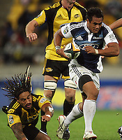 Blues second five Isaia Toeava skips out of the tackle of Ma'a Nonu during the Super 14 rugby union match between the Hurricanes and Blues at Westpac Stadium, Wellington, New Zealand on Friday 1 May 2009. Photo: Dave Lintott / lintottphoto.co.nz