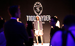 A model presents creations at the Todd Snyder Collection Spring 2013 Mercedes-Benz Fashion Week Show at The Box Lincoln Center in New York, United States. 07/09/2012. Photo by Kena Betancur/VIEWpress.