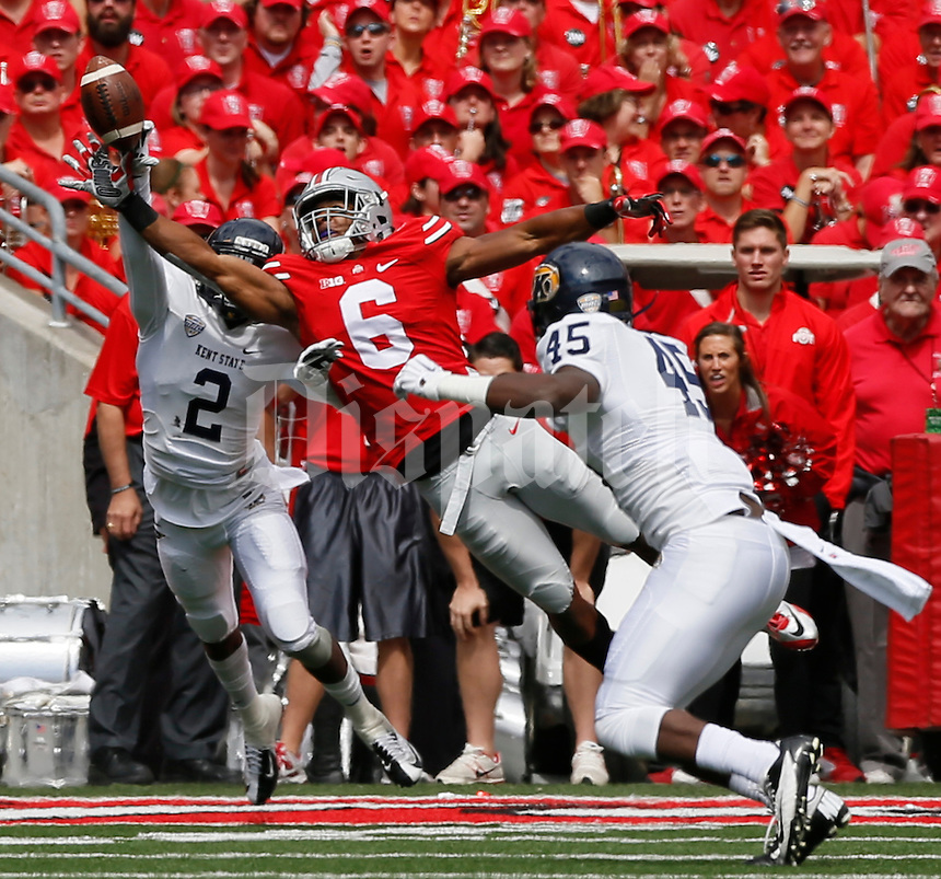 Ohio State Buckeyes wide receiver Evan Spencer (6) cant' catch a pass while defended by Kent State Golden Flashes cornerback Malcolm Pannell (2) and Kent State Golden Flashes linebacker Marques Moore (45) during Saturday's NCAA Division I football game at Ohio Stadium in Columbus on September 13, 2014. (Dispatch Photo by Barbara J. Perenic)