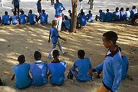 Eritrea. Anseba province. Keren. Keren secondary school. Students, wearing blue uniforms, some seat on the small wall, others walk. © 2006 Didier Ruef