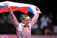 August 11, 2012; London, Great Britain;  EVGENIYA KANAEVA of Russia celebrates winning gold in rhythmic gymnastics individual All-Around final at London 2012 Olympics.