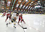 12 December 2009: University of Vermont Catamount forward Colin Vock, a Senior from Detroit, MI, looks to keep control of the play against the St. Lawrence University Saints at Gutterson Fieldhouse in Burlington, Vermont. The Catamounts shut out their former ECAC rival Saints 3-0. Mandatory Credit: Ed Wolfstein Photo