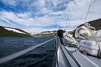 Sailing into a fjord in the Hornstrandir peninsula, Westfjords, Iceland