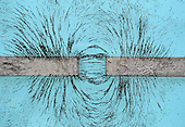 Magnetic field shown with iron grains, bar magnets, unlike poles facing