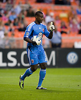 Bill Hamid (28) of D.C. United signals to his team during the game at RFK Stadium in Washington, DC.  D.C. United tied FC Dallas, 0-0.