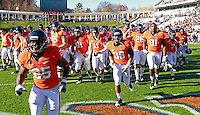 CHARLOTTESVILLE, VA- NOVEMBER 12:  Virginia Cavalier players run off the field before the game against the Duke Blue Devils on November 12, 2011 at Scott Stadium in Charlottesville, Virginia. Virginia defeated Duke 31-21. (Photo by Andrew Shurtleff/Getty Images) *** Local Caption ***