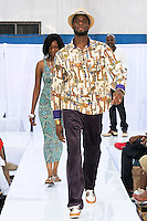 Fashion designer Moe Moorscode and Noble Rey walk runway at the close of the Moorscode runway show during the JRG Bikini Under The Bridge 2012 fashion show on July 9, 2012.