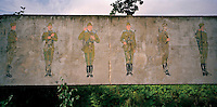 Mural of Russian soldiers on parade on the wall of a former Russian army barracks from the Cold War era.. CHECK with MRM/FNA
