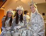 The Snow Queen and her court pose before the start of the parade.