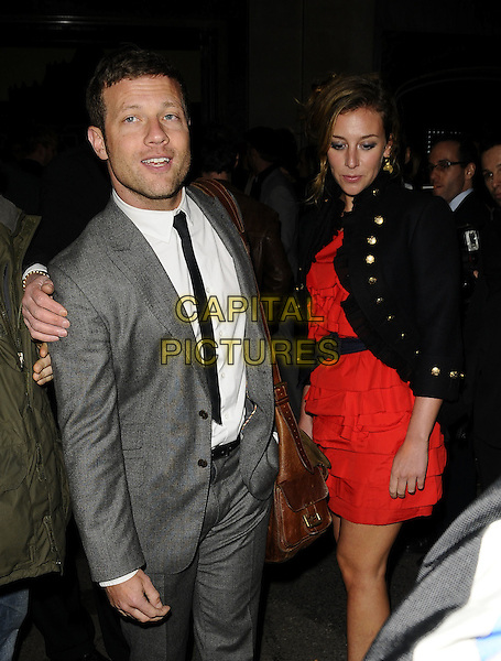 DERMOT O'LEARY & DEBORAH KOPPANG (?).The Universal Music Brit Awards 2009 Afterparty, Claridge's Hotel, Brook St., London, England..February 18th, 2009.brits half 3/4 length grey gray suit red dress black jacket couple stubble facial ahir brown leather satchel bag .CAP/CAN.©Can Nguyen/Capital Pictures.