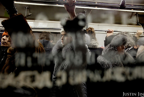 Passengers inside a train on the Moscow ring line. .The Moscow Metro, which spans almost the entire Russian capital, is the world's second most heavily used metro system after the Tokyo's twin subway. Opened in 1935, it is well known for the ornate design of many of its stations, which contain outstanding examples of socialist realist art.