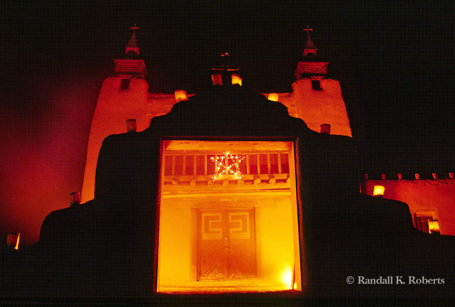 Luminaria bonfires light up San José de Gracia church  during the December Pastores service, in Las Trampas, New Mexico.