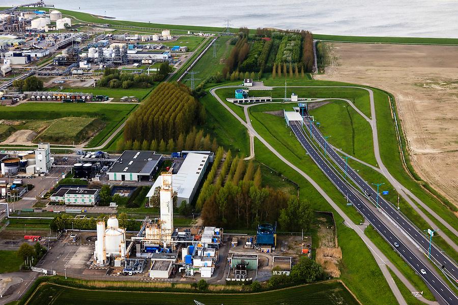 Nederland, Zeeland, Terneuzen, 09-05-2013; Zeeuws-Vlaanderen, Terneuzen, zuidelijk ingang van de Westerscheldetunnel. Links de chemische fabrieken van Dow Chemical.<br /> Tunnel entrance of the tunnel in the Westerschelde, connecting Zeeuws-Vlaanderen and Zuid-Beveland in the province of Zeeland.<br /> luchtfoto (toeslag op standard tarieven);<br /> aerial photo (additional fee required);<br /> copyright foto/photo Siebe Swart.