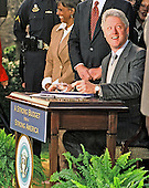 United States President Bill Clinton signs the Consolidated Appropriations Act for Fiscal Year 2000, providing funding for education, public safety, the environment, international leadership, health care and other priorities in the Rose Garden of the White House in Washington, DC on November 29, 1999.  The President also pushed Congress to complete his agenda when it returns in January, 2000.<br /> Credit: Ron Sachs / CNP
