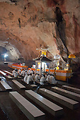 Hindu worshippers at the main altar in the cave temple complex at Goa Giri Putri on Nusa Penida, Bali, Indonesia