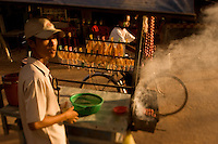 A boy sells dried squid on the street in Siem Reap, Cambodia.