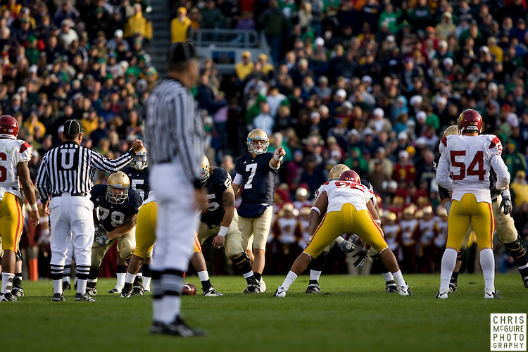 10/17/09 - South Bend, IN:  Notre Dame quarterback Jimmy Clausen checks out the USC defense at Notre Dame Stadium on Saturday.  USC won the game 34-27 to extend its win streak over Notre Dame to 8 games.  Photo by Christopher McGuire.