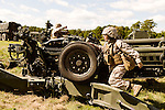 October 22, 2014. Camp LeJeune, North Carolina.<br />  Pfc. Livier Vielehr of artillery Battery A of the Ground Combat Element Integrated Task Force, climbs over one of the legs of her unit's M777 howitzers. Pfc. Vielehr has the MOS of field artillery cannoneer (0811), a job previously closed to women.<br />  The Ground Combat Element Integrated Task Force is a battalion level unit created in an effort to assess Marines in a series of physical and medical tests to establish baseline standards as the Corps analyze the best way to possibly integrate female Marines into combat arms occupational specialities, such as infantry personnel, for which they were previously not eligible. The unit will be comprised of approx. 650 Marines in total, with about 400 of those being volunteers, both male and female. <br />  Jeremy M. Lange for the Wall Street Journal<br /> COED