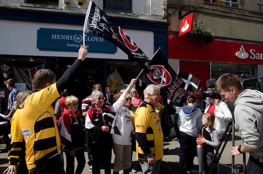 Cornish Pirates rugby fans gather to celebrate their captain Gavin Cattle, carrying the Olympic Torch through Falmouth, United Kingdom