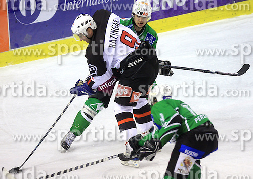 Tomaz Razingar vs Igor Cvetek at 39th Round of EBEL League ice hockey match between HDD Tilia Olimpija and HK Acroni Jesenice, on December 30, 2008, in Arena Tivoli, Ljubljana, Slovenia. Tilia Olimpija won 4:3. (Photo by Vid Ponikvar / SportIda).