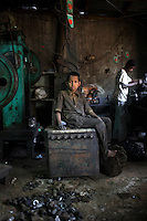 Eight year old Munna works in a rickshaw factory. He earns about 500 taka (7 USD) a month, working 10 hours a day. When the production often stops due to lack of electricity, he has time to play. It is common in Bangladesh for children of poor parents to work in various hazardous and labour-intensive workplaces to support their families. 17.5 percent of all children aged between 5-15 are engaged in economic activities. The average child labourer earns between 400 to 700 taka (1 USD = 70 taka) per month, while an adult worker earns up to 5,000 taka per month.