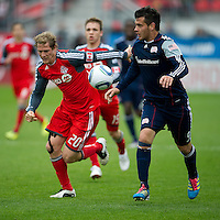 22 October 2011: New England Revolution forward Milton Caraglio #9 and Toronto FC defender Ty Harden #20 in action during a game between the New England Revolution and Toronto FC at BMO Field in Toronto..The game ended in a 2-2 draw.