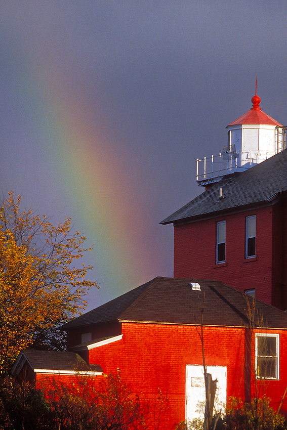 A rainbow arches near the Marquette Lighthouse in Marquette Michigan on Lake Superior.
