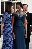 Samantha Cameron (L), First lady Michelle Obama and British Prime Minister David Cameron (R) greet one another on the North Portico of the White House March 14, 2012 in Washington, DC. Cameron is on a three-day visit to the U.S. and he was expected to have talks with Obama on the situations in Afghanistan, Syria and Iran..Credit: Chip Somodevilla / Pool via CNP