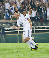 Real midfielder Xabi Alonso (14) and defender Ezequiel Garay (19) celebrate a goal during the second half of the friendly game between LA Galaxy and Real Madrid at the Rose Bowl in Pasadena, CA, on August 7, 2010. LA Galaxy 2, Real Madrid 3.