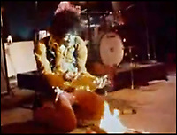 BNPS.co.uk (01202 558833)<br /> Pic: Collect<br /> <br /> Hendrix on fire at the Monterey festival.<br /> <br /> The guitar rock legend Jimi Hendrix tricked his fans into thinking he had burned on stage at a famous concert 50 years ago has emerged for auction and is tipped to sell for &pound;500,000.<br /> <br /> Hendrix was said to be so fond of the Fender Strat that he couldn't bring himself to destroy it. <br /> <br /> Instead, the guitar was swapped at the last minute before playing Wild Thing and then famously set on fire at the Monterey International Pop Festival.<br /> <br /> The moment he knelt down and poured lighter fluid onto the instrument before taking a match to it has become one of the most iconic images in rock history.